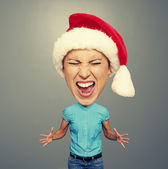 Angry screaming girl in santa hat — Stock Photo