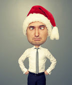 Funny christmas man in red santa hat — Stock Photo
