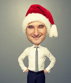 Smiley bighead man in santa hat — Stock Photo