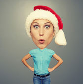 Surprised bighead girl in santa hat — Stock Photo