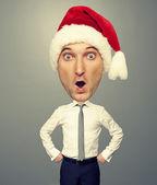 Surprised bighead man in santa hat — Stock Photo