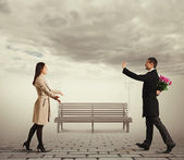 Couple going to meet each other in the park — Stock Photo