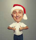 Funny smiley senior man in red santa hat — Stock Photo