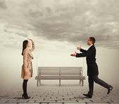 Woman waving man going to meet — Stock Photo