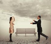 Woman waving man going to meet — Stock Photo