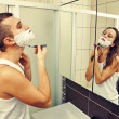Man shaving and looking at a woman — Stock Photo #36899923
