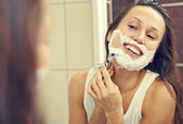 Woman shaving her face — Stock Photo