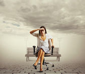 Woman sitting on the office chair at outdoor — Stock Photo