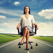 Woman sitting in the office chair on road — Stock Photo #40099945