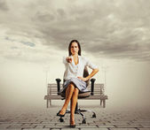 Businesswoman sitting on the office chair — Stock Photo