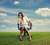 Doleful businesswoman sitting — Stock Photo