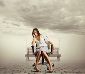 Tired young woman sitting — Stock Photo
