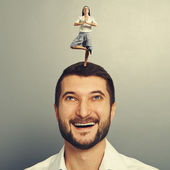 Woman standing on the head of happy man — Stock Photo