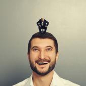 Man looking up at small businessman — Stock Photo