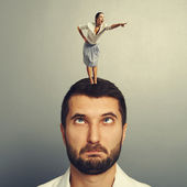 Woman standing on the head and pointing — Stock Photo