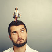 Man looking at strict woman on his head — Stok fotoğraf
