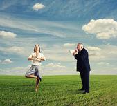 Emotional man screaming at calm woman — Stock Photo