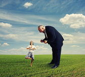 Aggressive man and meditation woman — Stock Photo