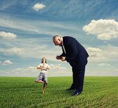 Aggressive man and meditation woman — Stock Photo