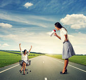 Woman with megaphone and joyful woman — Stock Photo
