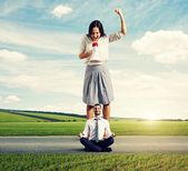 Angry woman and calm yoga man — Stock Photo