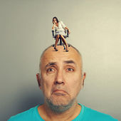 Sad man and small despondent woman — Stock Photo