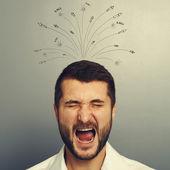 Stressed businessman over grey — Stock Photo