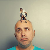 Tired man with small doleful woman — Stock Photo