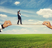 Frightened man balancing on the rope — Stock Photo