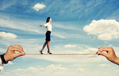 Smiley woman walking on the rope — Stock Photo