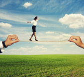 Startled woman balancing on the rope — Stock Photo