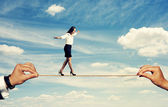 Woman walking on the rope — Stock Photo