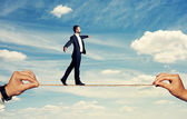 Smiley businessman walking on the rope — Stock Photo