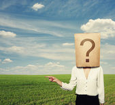 Woman with big question pointing — Stock Photo