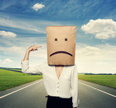 Woman with paper bag on the head — Stock Photo