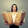 Woman holding two paper bags with money — Stock Photo #48859887