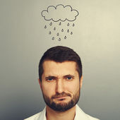 Dissatisfied man with drawing storm cloud — Stock Photo