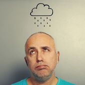 Man with drawing storm cloud — Stock Photo
