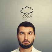 Stressed man with drawing storm cloud — Stock Photo