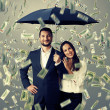 Couple under money rain — Stock Photo #49286763