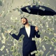 Man standing under money rain — Stock Photo #49286917