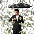 Man under money rain looking at watch — Stock Photo #49286921