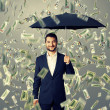 Smiley and glad man under money rain — Stock Photo #49286963