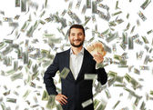 Man with euro standing under money rain — Stock Photo