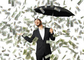 Smiley glad businessman with umbrella — Stock Photo