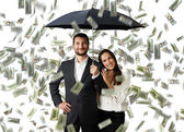 Smiley couple with black umbrella — Stock Photo