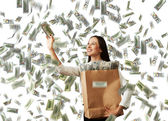 Successful woman catching money — Stock Photo