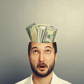 Amazed man with money in the head — Stock Photo