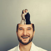 Couple in love standing in the man's head — Stock Photo