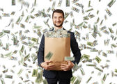 Smiley businessman with money — Stock Photo